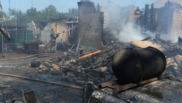 Private houses destroyed during an artillery attack by the Ukrainian army - Sputnik International