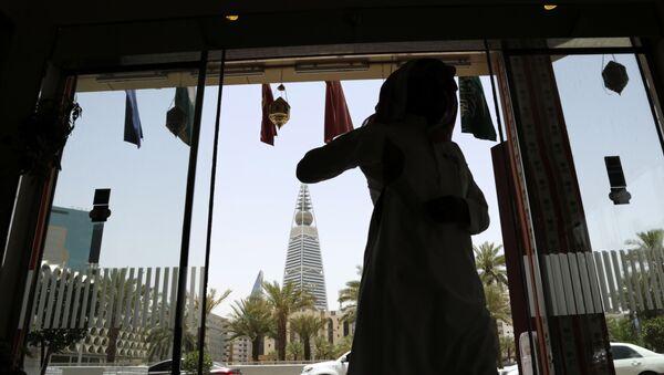 A Saudi man enters a hotel decorated for the Muslim holly month of Ramadan, Riyadh, Saudi Arabia, Monday, June 15, 2015. - Sputnik International
