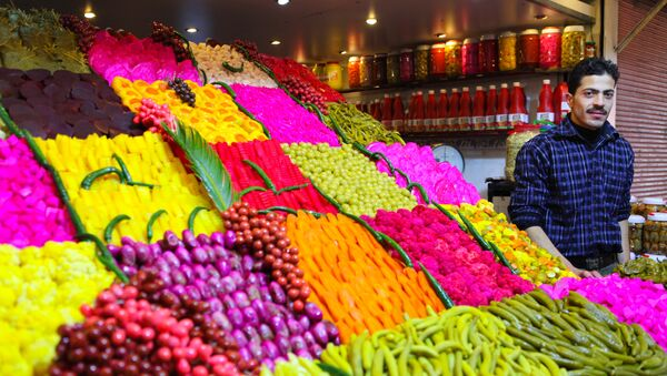 Stand offering various sourts of pickeled and colored vegetables at a covered street market in central Damascus - Sputnik International