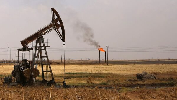 Oil well pumps are seen in the Rmeilane oil field in Syria's northerneastern Hasakeh province - Sputnik International