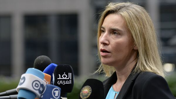 EU foreign policy chief Federica Mogherini speaks to the press as she arrives for a summit on relations between the European Union and Turkey and on the migration crisis at the EU headquarters in Brussels on November 29, 2015. - Sputnik International