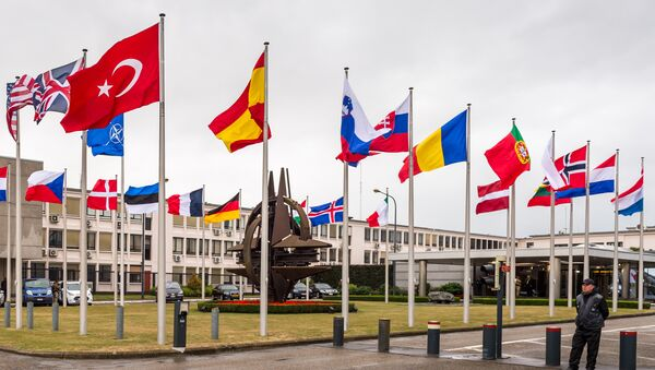 NATO country flags wave outside NATO headquarters in Brussels on Tuesday July 28, 2015 - Sputnik International