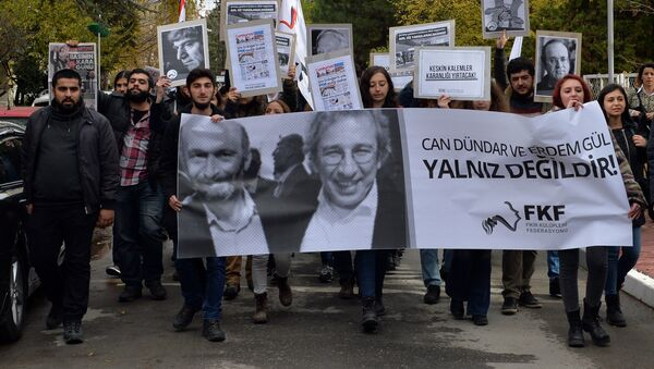 This file photo shows people demonstrating against the jailing of opposition Cumhuriyet newspaper's editor-in-chief Can Dundar and Ankara representative Erdem Gul, in Ankara, Turkey, Friday, Nov. 27, 2015 - Sputnik International