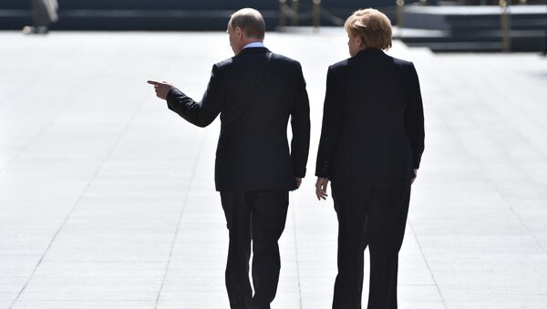 Putin and Merkel - Sputnik International