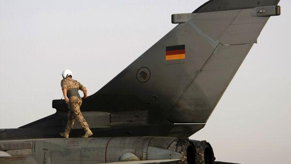 File photo of a German soldier walking on a Tornado fighter jet before a reconnaissance flight from the German camp in Mazar-e-Sharif August 28, 2009 - Sputnik International