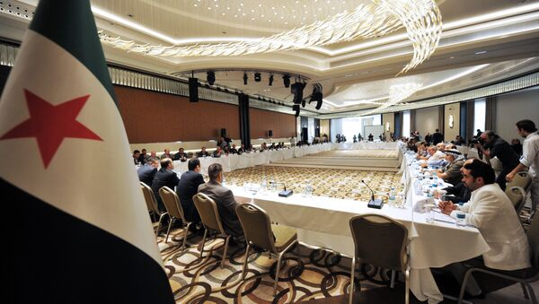 Members of Syrian National coalition (SNC) attend a meeting of the National Coalition of Syrian Revolution and Opposition forces on September 13, 2013, in Istanbul - Sputnik International