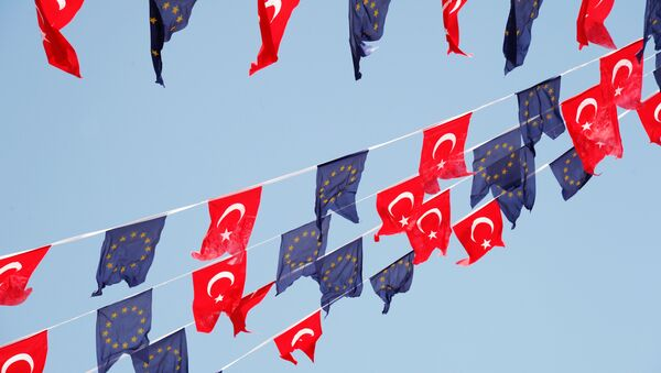 Turkish and European Union flags fly together at Taksim Square on May 24, 2013, in Istanbul - Sputnik International