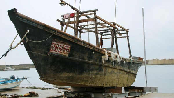 An unidentified wooden boat that was found in the sea off Noto Peninsula is seen in Wajima, Japan. - Sputnik International