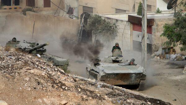Syrian APC is followed by a tank in Harasta, northeast of Damascus, Syria, Thursday, Oct. 22, 2015 - Sputnik International