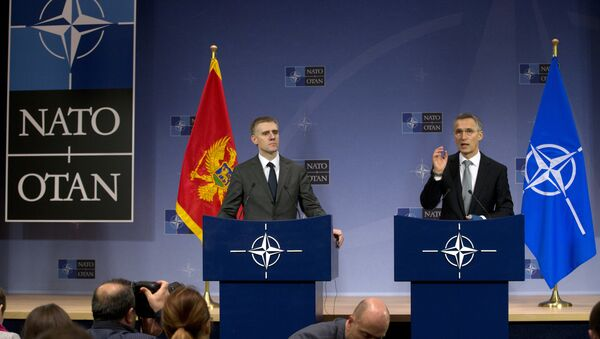 NATO Secretary General Jens Stoltenberg, right, and Montenegro's Foreign Minister Igor Luksic address a media conference at NATO headquarters in Brussels on Wednesday, Dec. 2, 2015 - Sputnik International