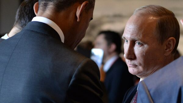 Russian President Vladimir Putin (R) speaks with US President Barack Obama (L) before the Asia-Pacific Economic Cooperation (APEC) Summit plenary session at the International Convention Center in Beijing on November 11, 2014 - Sputnik International