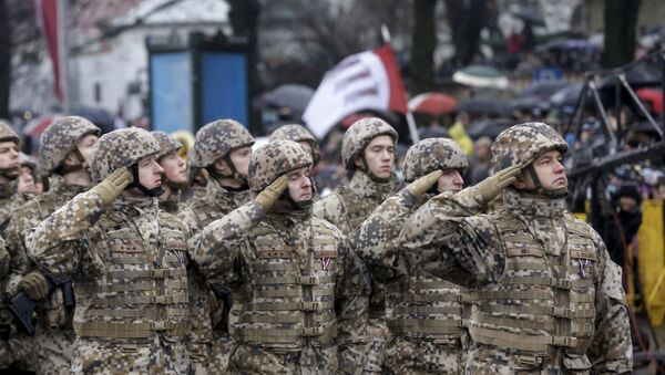 Soldiers from the Latvian army salute as they march during Independence Day military parade in Riga, Latvia, November 18, 2015 - Sputnik International