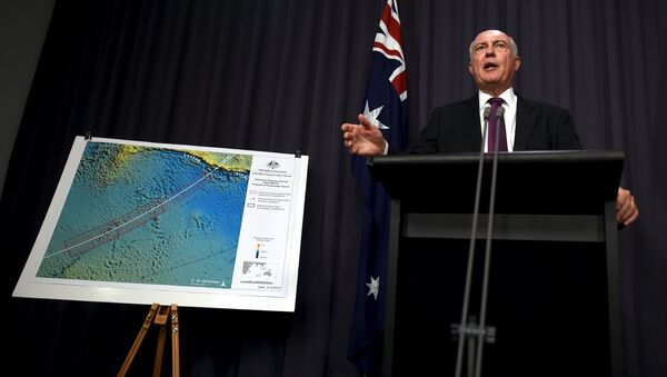 Australia's Deputy Prime Minister Warren Truss speaks during a media conference next to a map displaying the search area for missing Malaysia Airlines Flight MH370 at Parliament House in Canberra, Australia, December 3, 2015 - Sputnik International
