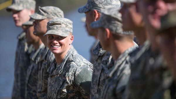 Maj. Lisa Jaster, center, stands in formation with other Rangers during an Army Ranger school graduation ceremony, Friday, Oct. 16, 2015, in Fort Benning, Ga. - Sputnik International