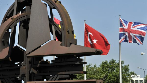 A Turkish and an Union Jack flags are pictured at the NATO Headquarters in Brussels - Sputnik International