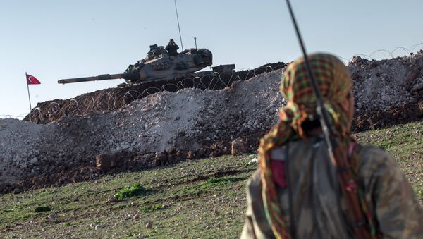 A Syrian Kurdish militia member of YPG patrols near a Turkish army tank as Turks work to build a new Ottoman tomb in the background in Esme village in Aleppo province, Syria. (File) - Sputnik International
