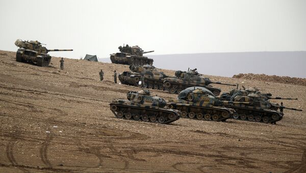 Turkish soldiers hold their positions with their tanks on a hilltop on the outskirts of Suruc, at the Turkey-Syria border . file photo - Sputnik International