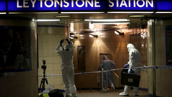 Police officers investigate a crime scene at Leytonstone underground station in east London - Sputnik International