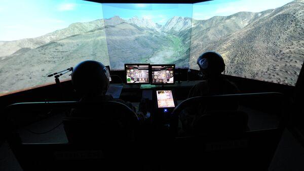 A picture taken on June 29, 2015 shows a flight simulator. - Sputnik International