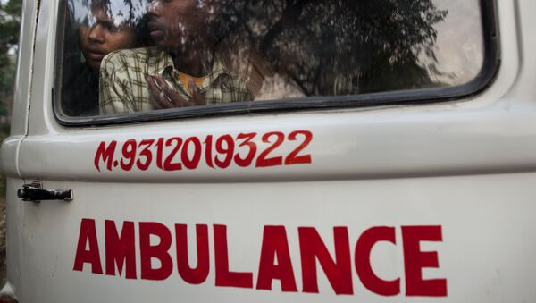 Relatives look out through an ambulance window as they take for burial the body of a man who died in the collapse of a four-story apartment building in New Delhi, India, Tuesday, Nov. 16, 2010 - Sputnik International