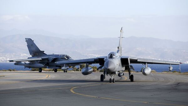 Two British Tornados taxi on the runway, after returning from a mission, at RAF Akrotiri in southern Cyprus December 3, 2015 - Sputnik International