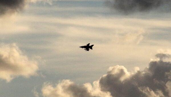 A British Tornado jet flies above RAF Akrotiri, a peninsula on the southern coast of Cyprus where Britain retains a military air base, Cyprus December 2, 2015 - Sputnik International