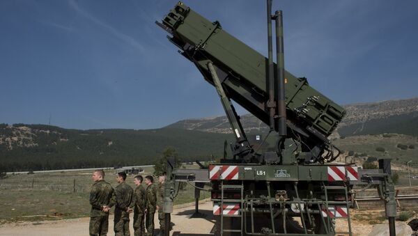German soldiers stand to attention in front of a German Patriot missile launcher at the Gazi barracks in Kahramanmaras, southern Turkey on March 25, 2014 - Sputnik International