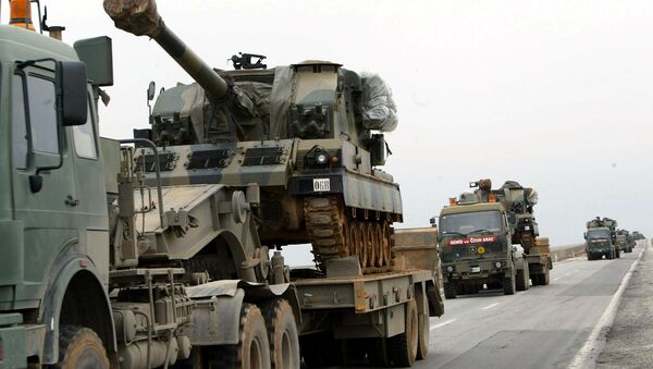 A large convoy of Turkish military including tanks and ambulances rolls  from the southeastern part of Turkey toward the Iraqi border (File) - Sputnik International