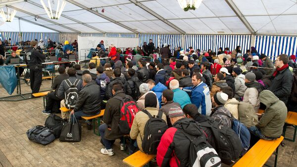 Refugees wait to be registered in a service tent at the train station in the Bavarian city of Passau, southern Germany, Monday, Nov. 2, 2015. - Sputnik International