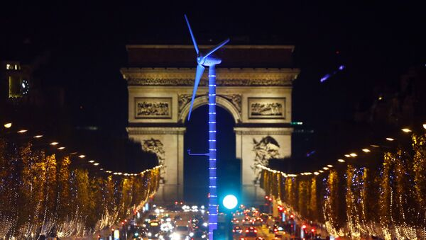 A power-generating windmill turbine is seen on the Champs Elysees avenue with the Arc de Triomphe in background as part of the COP21, United Nations Climate Change Conference, in Paris, Wednesday, Dec. 2, 2015 - Sputnik International