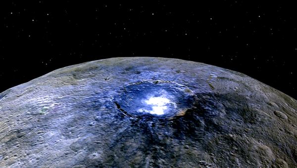 This representation of Ceres' Occator Crater in false colors shows differences in the surface composition. - Sputnik International