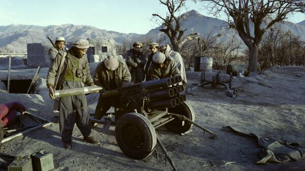 Afghan mujahideen prepare a rocket attack on the government troops in Shaga, Eastern Nangarhar province, on January 15, 1989 during the Afghan Civil War opposing the Islamic Unity of Afghanistan Mujahideen and the Democratic Republic of Afghanistan (DRA) supported by Soviet Union - Sputnik International