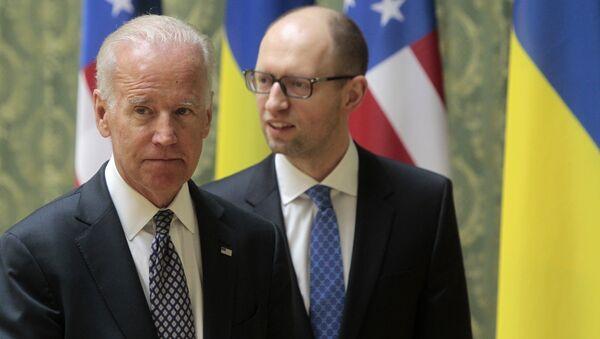 US Vice President Joe Biden, left, and Ukrainian Prime Minister Arseniy Yatsenyuk leave after delivering a joint statement to the press in Kiev, Ukraine, Tuesday, April 22, 2014. - Sputnik International