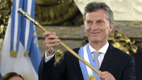 Argentine President Mauricio Macri, already wearing the presidential sash and staff, poses during his inauguration at the Casa Rosada government palace in Buenos Aires on December 10, 2015 - Sputnik International