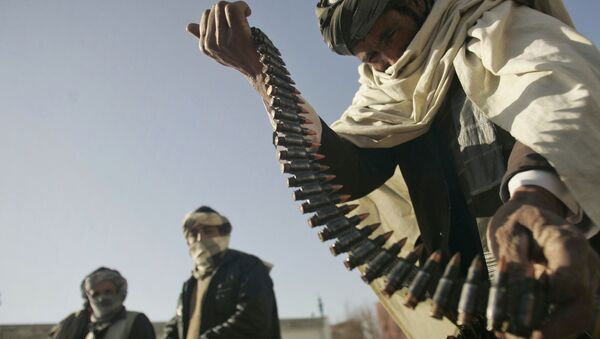 FILE - In this Dec. 28, 2011 file photo, a former Taliban fighter places a range of bullets before surrendering it to Afghan authorities, as part of a peace-reconciliation program in Herat, west of Kabul, Afghanistan - Sputnik International