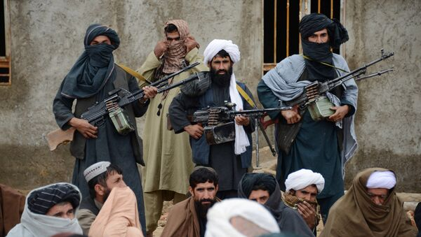 In this Tuesday, Nov. 3, 2015 photo, Afghan Taliban fighters listen to Mullah Mohammed Rasool, unseen, the newly-elected leader of a breakaway faction of the Taliban, in Farah province, Afghanistan - Sputnik International