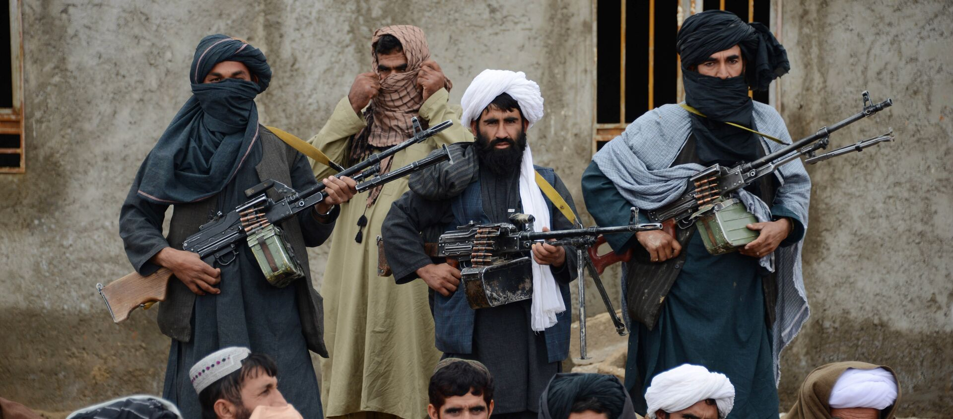 In this Tuesday, 3 November 2015 photo, Afghan Taliban fighters listen to Mullah Mohammed Rasool, unseen, the newly-elected leader of a breakaway faction of the Taliban, in Farah province, Afghanistan - Sputnik International, 1920, 13.08.2021
