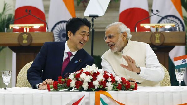 Japan's Prime Minister Shinzo Abe (L) and his Indian counterpart Narendra Modi shares a moment during a signing of agreement at Hyderabad House in New Delhi, India, December 12, 2015 - Sputnik International