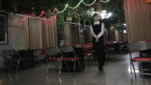 In this Monday, Nov. 30, 2015, photo, a waitress waits to serve customers in a Korean BBQ restaurant in Pyongyang, North Korea - Sputnik International