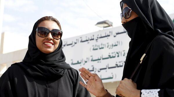 Saudi women leave a polling station after casting their votes during municipal elections, in Riyadh, Saudi Arabia December 12, 2015 - Sputnik International