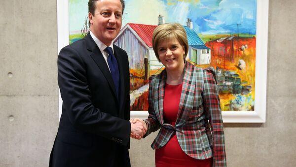 Britain's Prime Minister David Cameron is greeted by Scotland's First Minister Nicola Sturgeon at her office at the Scottish Parliament, Edinburgh, Scotland, Thursday Jan. 22, 2015. - Sputnik International