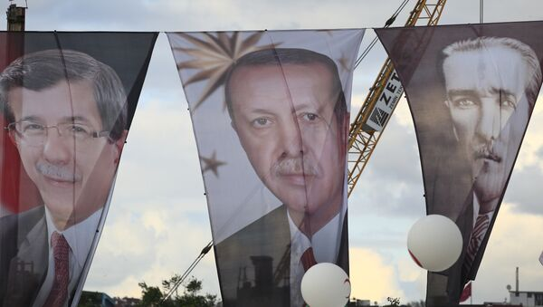 Banners from left to right show Turkish Prime Minister Ahmet Davutoglu, also leader of the Justice and Development Party (AKP); Turkey's current President Recep Tayyip Erdogan' and Turkish Republic founder Mustafa Kemal Ataturk - Sputnik International