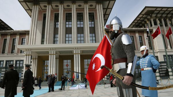 A Turkish military guard of honour in historical warrior gear stands outside President Recep Tayyip Erdogan's new, more than 1,000-room palace, after a ceremony for Iraqi President Fuad Masoum, in Ankara, Turkey, Wednesday, April 22, 2015 - Sputnik International