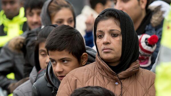 Migrants wait for registration at the Hesse state Initial Reception Center in Giessen, Germany, Wednesday Dec. 2, 2015. - Sputnik International