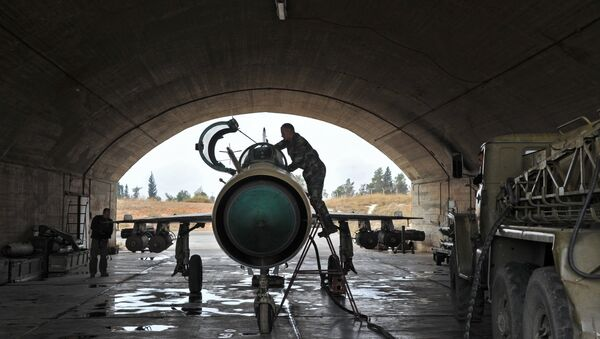 MiG-21 aircraft of the Syrian Air Force gets ready for a mission at the Hama airbase near the city of Hama, Syria's Hama Province - Sputnik International