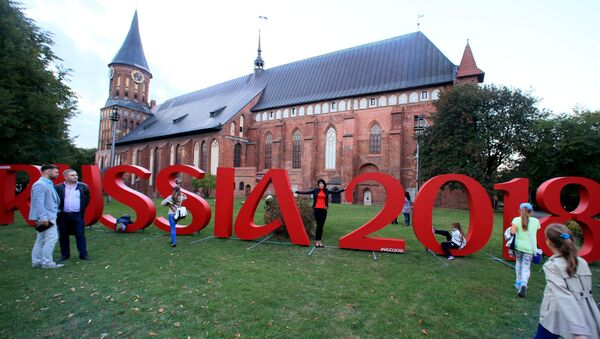 The official hashtag of the 2018 FIFA World Cup, which Russian will host, stands in front of the Konigsberg Cathedral, Kaliningrad - Sputnik International