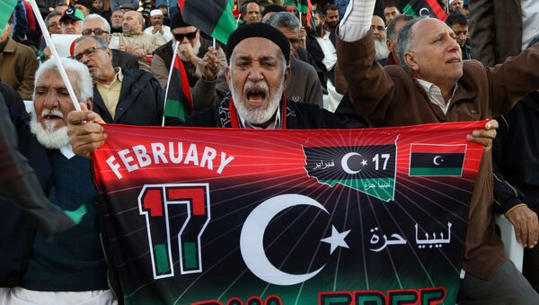 Libyan protesters shout slogans during a demonstration against a UN-sponsored agreement on forming a national unity government, on December 11, 2015 in the capital Tripoli. - Sputnik International