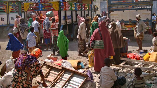 Displaced Somalis who had fled a severe famine in the south of the Horn of Africa country prepare to leave an internally displaced persons camp in Mogadishu January 8, 2012 to resettle back at their respective home regions - Sputnik International
