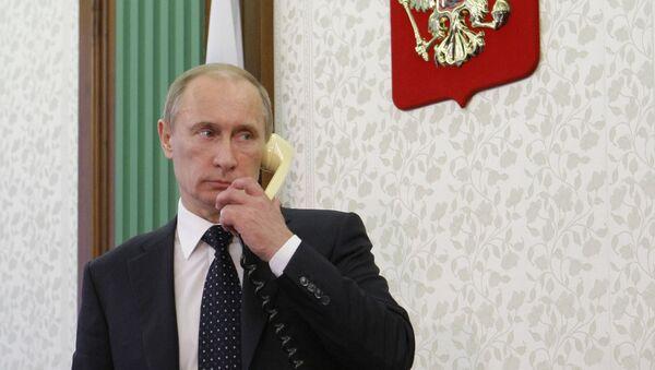 Russian President Vladimir Putin talks on the phone. File photo - Sputnik International