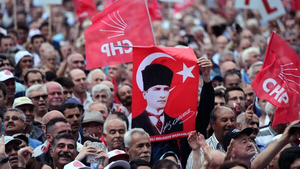 People hold a poster of Mustafa Kemal Ataturk, the founder of modern Turkey, as they listen to Turkey's main opposition Republican People's Party, CHP, leader Kemal Kilicdaroglu in Luleburgaz, Turkey, Wednesday, May 27, 2015 - Sputnik International